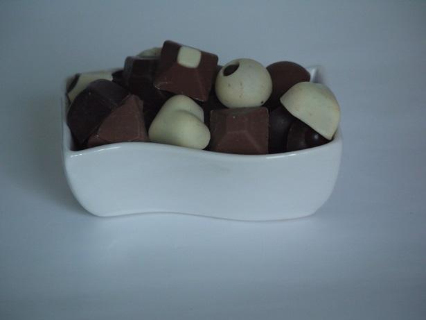 Incurvé 2€ pièce, peut contenir jusqu'à 200g de chocolats